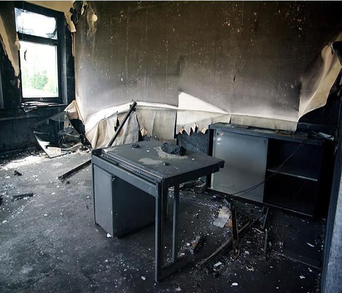 Burned interior and furniture in a commercial property.