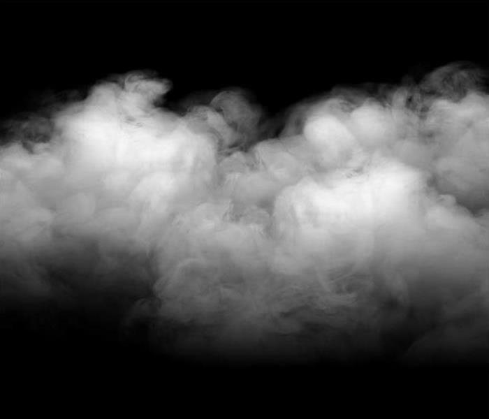Grey and white smoke on a black background.