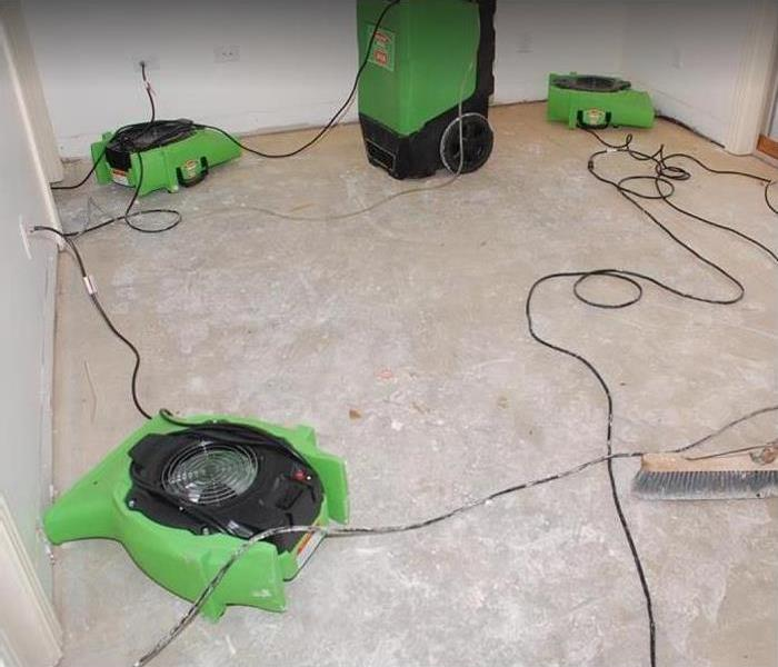 SERVPRO drying equipment being used in water damage room